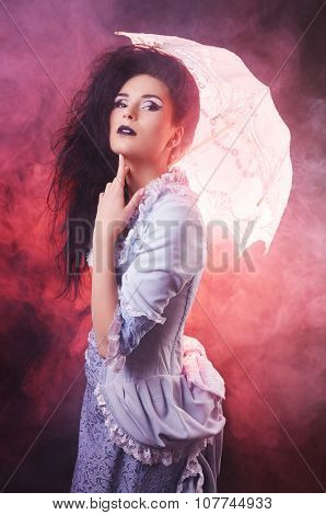 Beautiful Halloween vampire woman aristocrat with lace-parasol