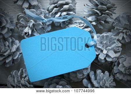 Light Blue Label On Fir Cones With Copy Space Frame