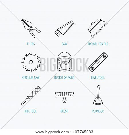 Trowel for tile, saw and brush tool icons.