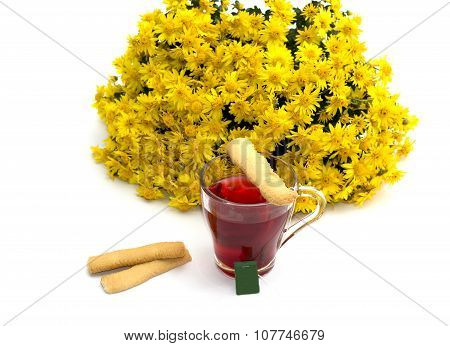 The Tea Decorated With Cookies And A Bouquet Of Yellow Flowers On A White Background