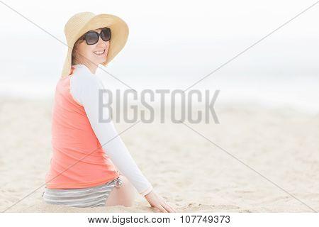 Woman In Rashguard