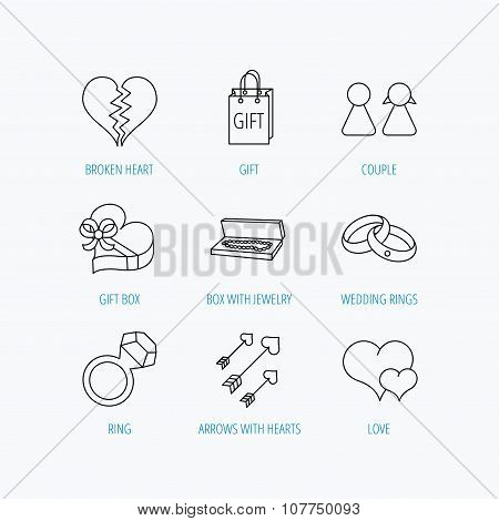 Love heart, gift box and wedding rings icons.