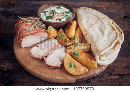 Served Rolled Meat And Potatoes