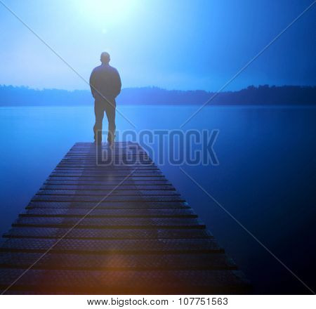 Man Standing Jetty Tranquil Lake Gloomy Fog Dusk Concept