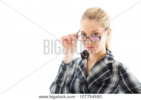 Attractive businesswoman in a plaid shirt and glasses