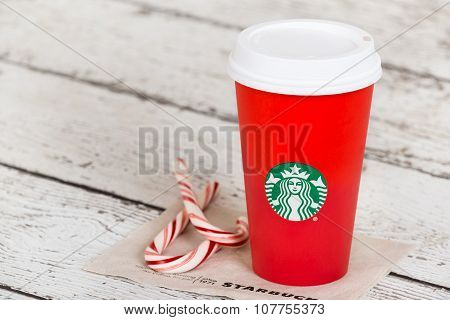 Starbucks holiday beverage in red cup
