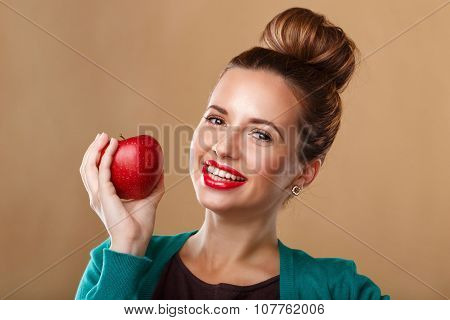 Girl With A Beautiful Smile Holding A Red Apple.