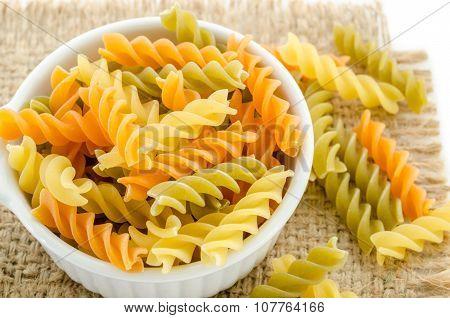 Dried Italian Pasta (macaroni) In White Bowl.