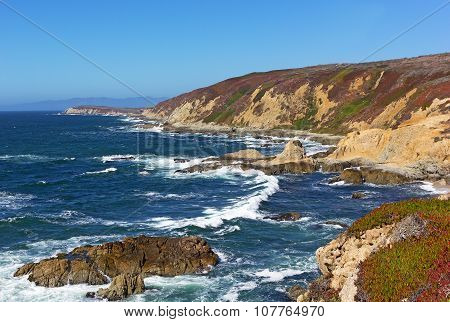 Panoramic view of the rocky and rugged Pacific coastal line.