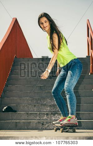 Girl On Stairs With Skateboard.