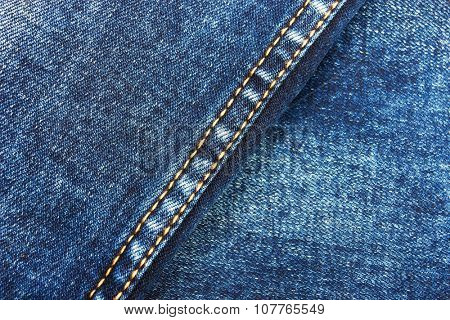 Jeans background with double thread's seam