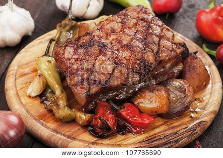 Roasted pork belly or bacon with spicy potato and vegetables