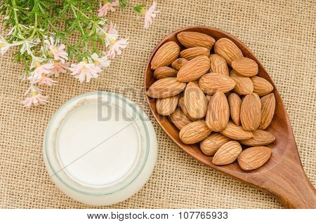 Almond Milk With Almond On A Wooden Spoon.