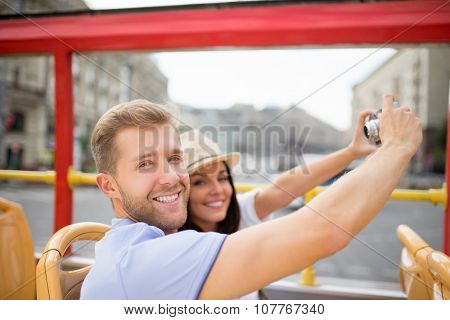 Smiling couple at the tour bus