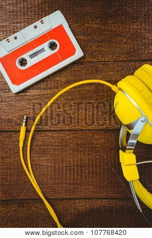 Close up view of old tape and headphone on wood desk