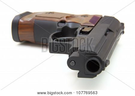 The Close Up Of A Pistol A Target And Cartridges Is Isolated On A White Background