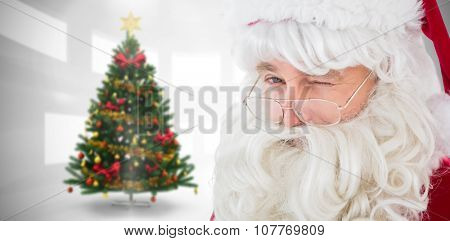 Portrait of santa claus winking against home with christmas tree