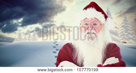 Santa smiles with folded arms against snowy landscape with fir trees