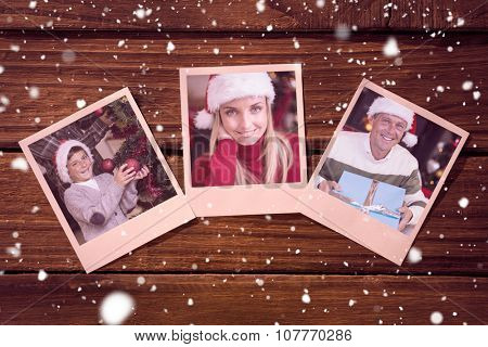 Instant photos on wooden floor against san and father decorating the christmas tree