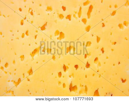 yellow cheese with holes.