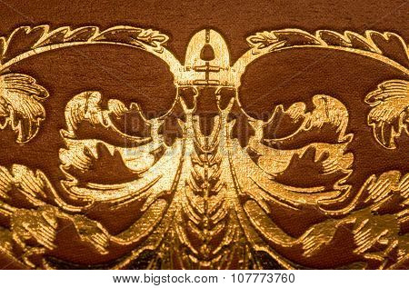 Gold Letter Swirls And Patterns On Brown Leather