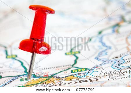 Red Pushpin On A Tourist Map