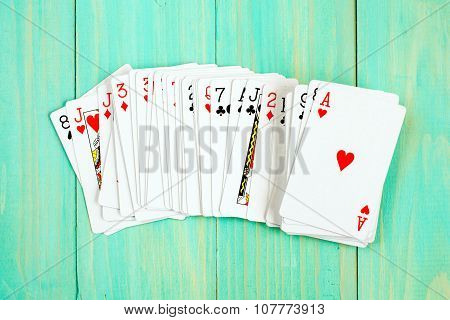 Playing Cards On Blue Wooden Background