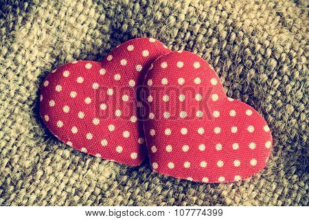 Two Decorative Hearts On Sackcloth Background