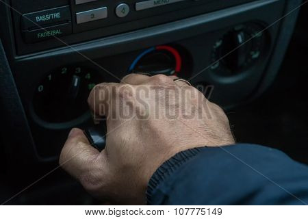 Man Changing Gear In An Automatic Car