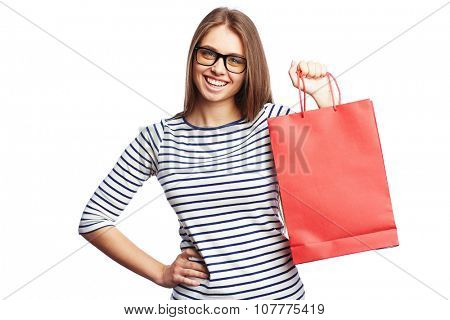 Happy young woman with red paperbag