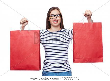 Happy buyer with paperbags looking at camera after shopping