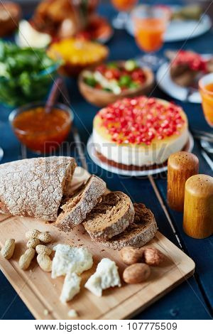 Slices of cut bread and nuts on served festive table