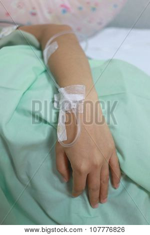 Saline Solution On Patients Woman Hand.