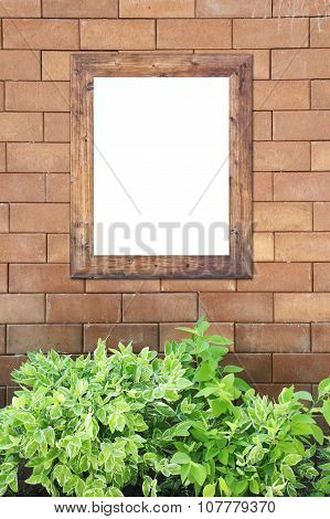 Brown Brick Wall Foully And Photo Frame.