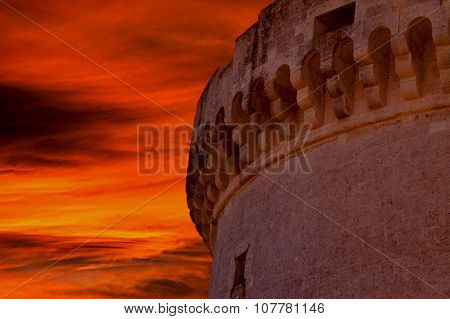 Ruins Of Medieval Old Tower Of Castle Under Sunset Sky