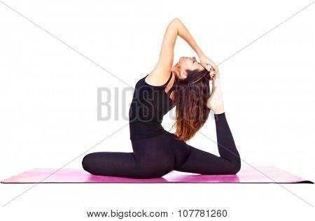 Beautiful woman exercising Eka Pada Rajakapotasana - One Legged King Pigeon pose yoga .