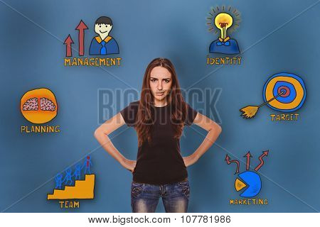 girl in shirt and jeans frowned dissatisfied with her hands on h