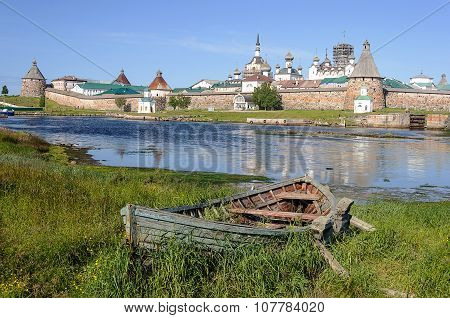 Old Wooden Boat On The Backfround Of Solovetsky Monastery