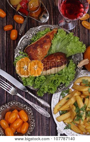 Chicken Fillet In A Crisp, French Fries And A Wine Glass