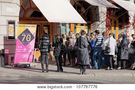 People Waiting For A Sale To Open