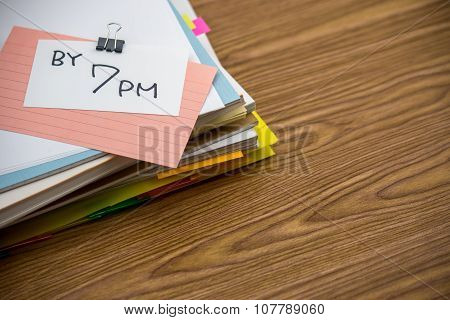 By 7 Pm; The Pile Of Business Documents On The Desk