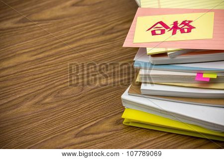 Approved; The Pile Of Business Documents On The Desk
