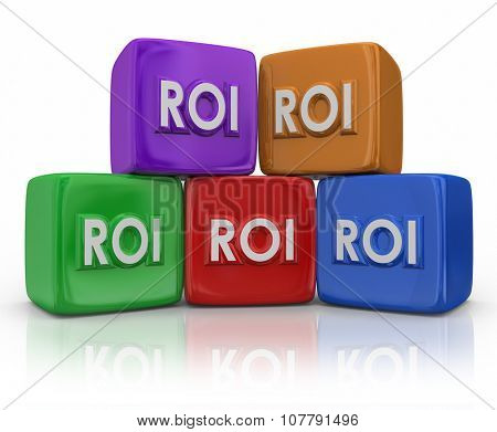 ROI Return on Investment letters on colorful blocks or cubes to illustrate measuring the amont of income or earnings as related to costs of investing