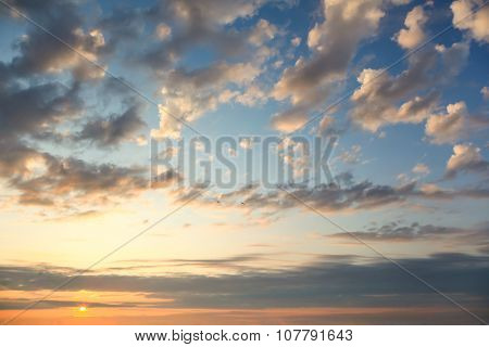 Gentle Sundown Sky with Sun and Colorful Clouds, natural background for wallpaper