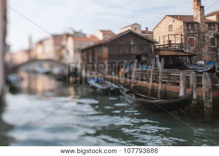 Tilt Shift Photo Of View Gondola Factory In Venice