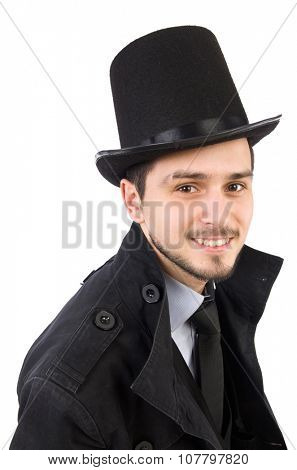 Young man in coat and hat isolated on white