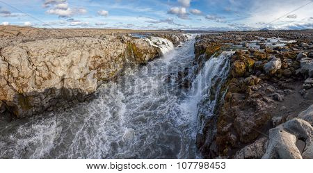 Narrow canyon of the glacier river Joekulsa a Fjoellum in the Highlands of Iceland near the Herdubreid Mountain panoramic shot