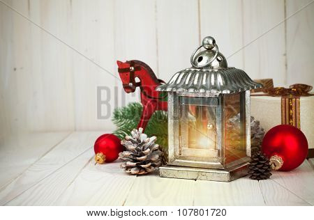 Christmas still life with lamp balls and gift on wooden board. Illustration