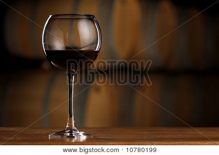 Glass of wine in wine cellar