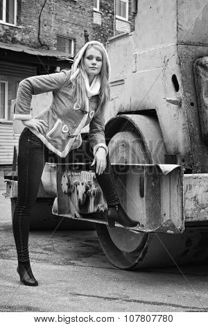 Casual Woman On A  Road Roller